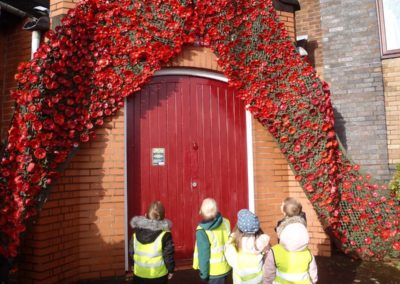 Children looking at poppies